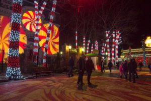 An area in the park decorated with red and white lights on the tree trunks to make them look like candy canes. (Photo: Six Flags America)