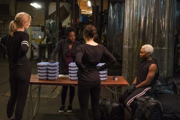 Elizabeth Debicki, Viola Davis, Michelle Rodriguez and Cynthia Erivo plan their heist in Widows. (Photo: 20th Century Fox)