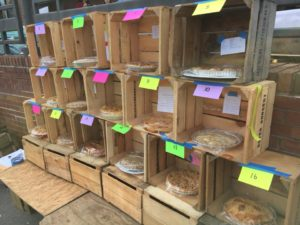 A display of 16 crates stacked on top of each other, each holding an apple pie. (Photo: Adams Morgan Apple Festival)