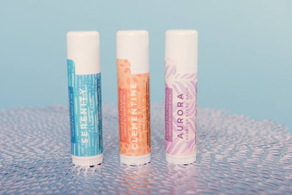 Three varieties of aromatherapy balm sticks sitting beside each other on a silver surface in front of a blue background. (Photo: Honestly Margo/Facebook)