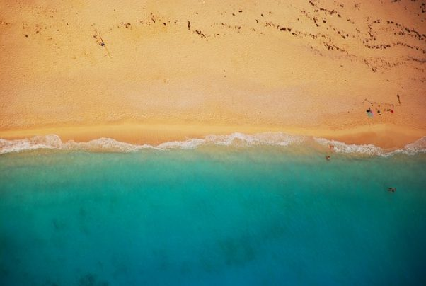 Shoreline with water meeting sand on a beach. (Photo: Foundry/Pixabay)