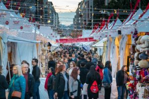 Shoppers walk among the tents at the Downtown Holiday Market. (Photo: Downtown Holiday Market)