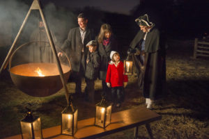 A family of 4 tour Mount Vernon by candlelight with a guide in period garb. (Photo: Mount Vernon)