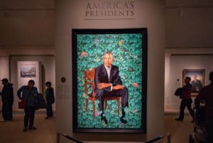 Portrait of Barack Obama hanging under a sign that says American Presidents in the National Portrait Gallery. (Photo: jschliev/Instagram)