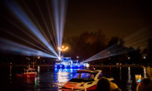 A boat in on the Potomac decorated in blue and white lights with a menorrah. (Photo: The Wharf)