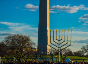 The National Menorah during the day time with the Washington Monument in the background. (Photo: Destination D.C.)