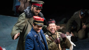 Three soldiers from different nations share a laugh. (Photo: Kennedy Center)
