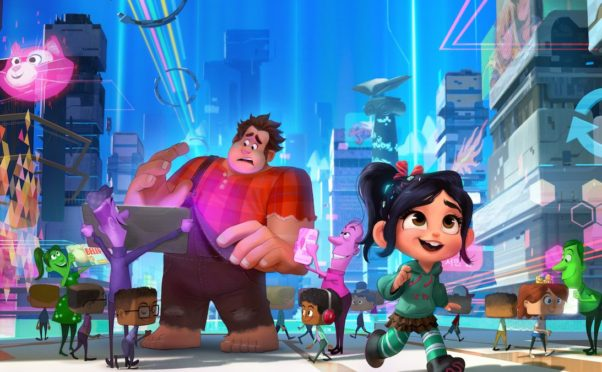 Wreck-It Ralph (voice of John C. Reilly) and Vanellope von Schweetz (voice of Sarah Silverman) travel to the world wide web. (Photo:  Walt Disney Studios)