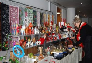 A woman examining items for sale at the Swedish Christmas Bazzar. (Photo: Li Ansefelt)