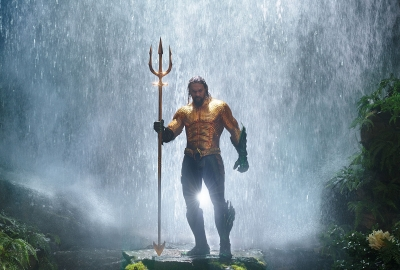 Aquaman stand shirtless with his trident. (Photo: Warner Bros.)