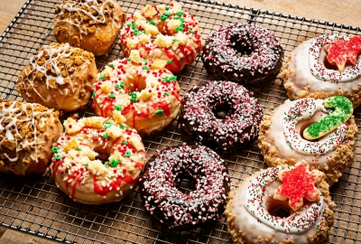 A tray of 12 doughnuts with four rows of three each in gingerbread pear (l to r), cake batter, chocolate candy cane andd Christmas cookie. (Photo: Scott Suchman)