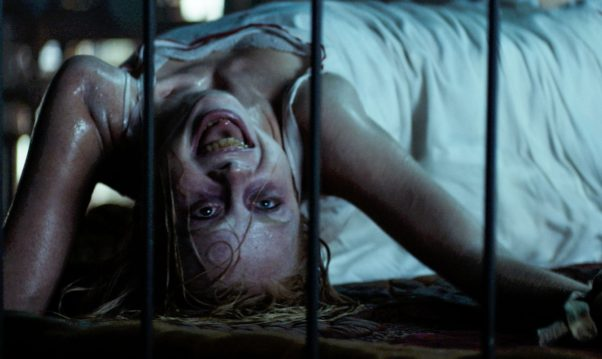 Hannah Grace (Kirby Johnson) possessed and tied to a bed. (Photo: Sony Pictures)