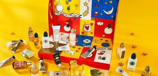 The L'Occitane Signature Advent Calendar box in red, blue and yellow with the enclosed products sitting around it. (Photo: L'Occitane)