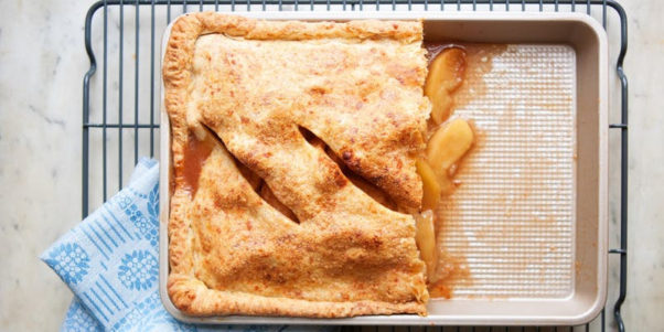 A half eaten apple slab pie on a baking sheet. (Photo: Buttercream Bakeshop)