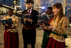 Carolers dressed in old time clothes caroling at the Wharf. (Photo; The Wharf)