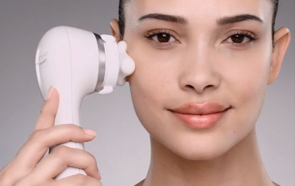A woman using a Clarisonic face brush. (Photo: Clarisonic)