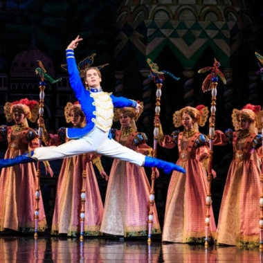 The Nutcracker leaps into the air in front of five women. (Photo: Luke Isley)