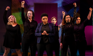 "The cast of ""She the People"" with fists raised. (photo: Wooly Mammoth Theatre)"