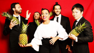 Members of Banda Magda holidng pineapples. (Photo: Kennedy Center)