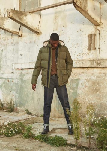 A black man in jeans wearing a winter coat. (Photo: Belstaff)