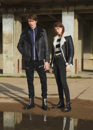 A man and woman standing outside in shearling jackets. (Photo: Belstaff)