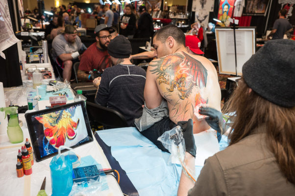 A man getting a large eagle tattooed on his back at the 2016 D.C. Tattoo Expo. (Photo: Mark Van Bergh)