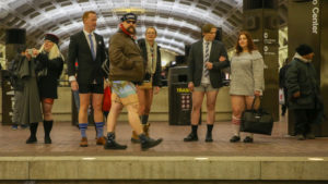 People standing without pants on a Metro platform. (Photo: Amanda Rhoades)