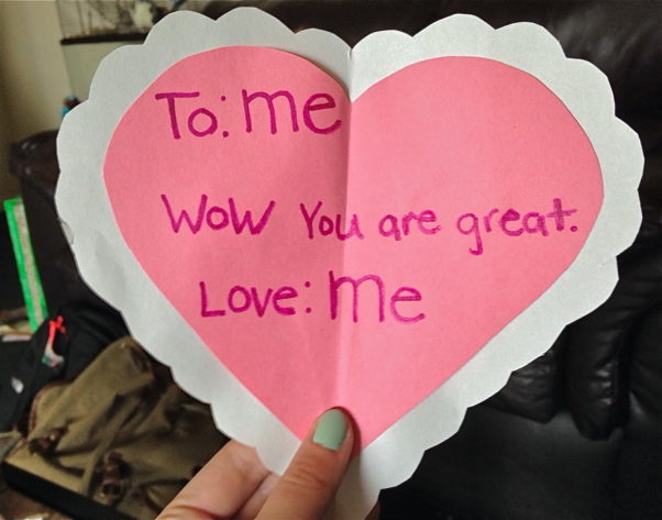 A homemade pink and white valentine card with hand printed letters that say: To: me, Wow you are great. Love: me. (Photo: Sarah Caskie)