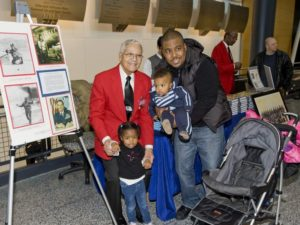 Tuskegee Airman Col. Charles McGee (left) standwith with a man and his two children at a past Air & Space Museum event. (Photo: Air and Space Museum)