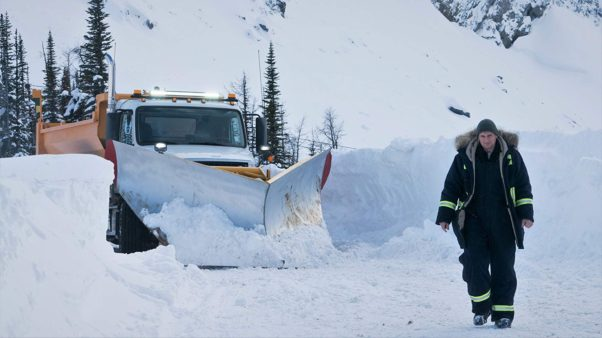 Liam Neeson walking in a snow storm in front of a plow. (Photo: Lionsgate Films)