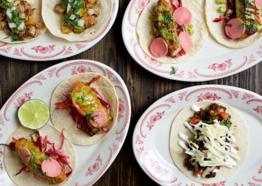 Four kinds of tacos on plates. (Photo: El Bebe)