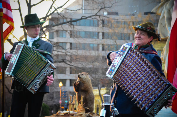 A male and female according player play in Dupont Circle with a stuffed groundhog standing between them. (Photo: Dupont Festival)