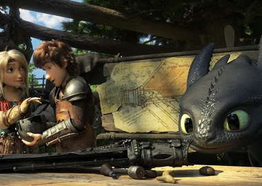Astrid, voiced by America Ferrera, and Hiccup, voiced by Jay Baruchel, make an artificial for Toothless as he looks on. (Photo: Universal Pictures)