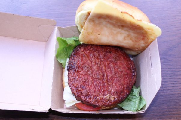 An open LOVe burger showign the redish vegan patty. (Photo: Mark Heckathorn/DC on Heels)