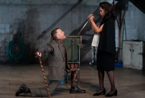 Matthew Rauch as King Richard III kneels in front of Cara Ricketts as Lady Anne of Neville, who holds a sword to his chest. (Photo: Scott Suchman)