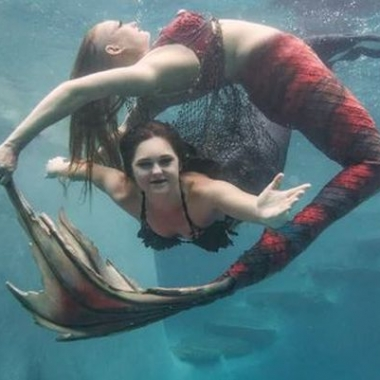 Two mermaids swim underwater. (Photo: Melanie Canatella)