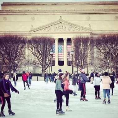 Skaters on the ice at the Natural Gallery of Art Sculpture Garden ice rink with the National Archives in the background. (Photo: louisedettman/Instagram)