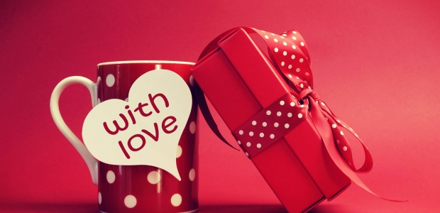 A red much with white polka dots and a paper heart that says with love beside a present in a red box tied with a red and white polka dot ribbon. (Photo: lovedignity.com)