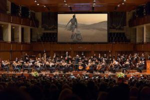 The National Symphony Orchestra plays along with <em>The Force Awakens</em> while the movie plays on a big screen having over the orchestra. (Photo: Scott Suchman)