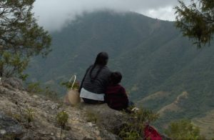 Soledad and José sit on a mountain looking at the other mountains around their village. (Photo: Iwao Kawasaki)