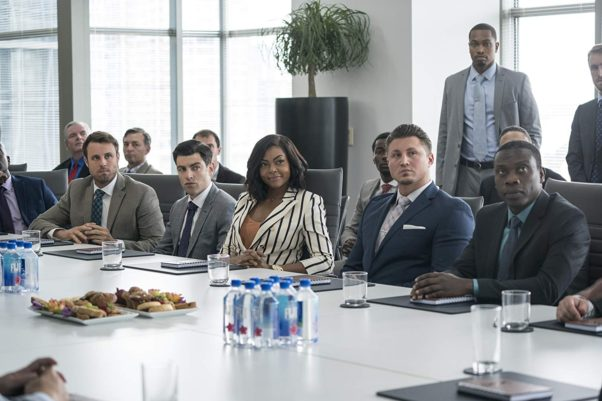 Taraji P. Henson sits at a conference with all men. (Photo: Paramount Pictures)