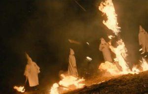 The Klu Klux Klan burns a cross in a scene from <em>BlackkKlansman</em>. (Photo: Focus Features)