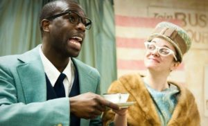An actor portraying Martin Luther King Jr. has tea with a white woman. (Photo: Bright Star Theatre)