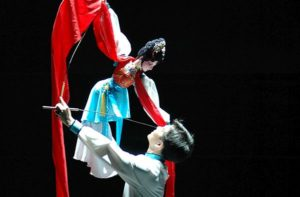 A Chinese puppeteer performs with a  marionette puppet. (Photo: Kennedy Center)