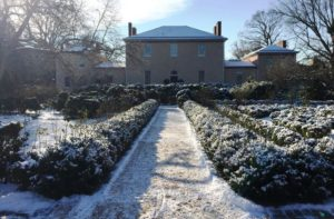 Photo of the outside of Tudor Place and the gardens with snow on the ground. (Photo: Tudor Place)