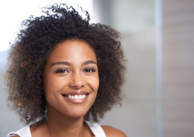 Closeup portrait of a naturally beautiful black woman. (Photo: Getty Images)