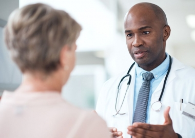 African American male doctor talking with a female patient. (Photo: Getty Images)
