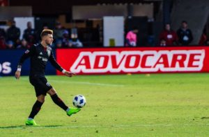A D.C. United player kicks the ball downfield. (Photo: D.C. United)