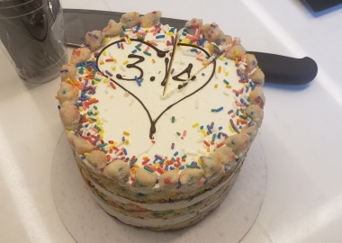 A Milk Bar birthday cake decorated with a heart on top and 3.14 inside the heart. (Photo: Mark Heckathorn/DC on Heels)