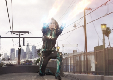 Captain Marvel (Brie Larson) shoots power out of her hands while on top of a subway train. (Photo: Marvel Studios)